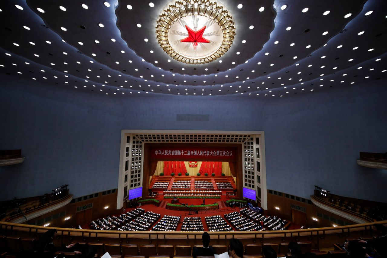 Delegates attend the National People's Congress at the Great Hall of the People on March 12, 2017 in Beijing.