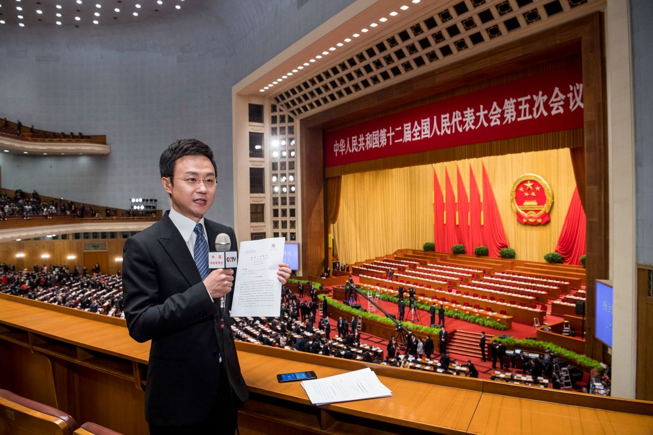 A journalist reports during the opening ceremony of the NPC on March 5, 2017 in Beijing.