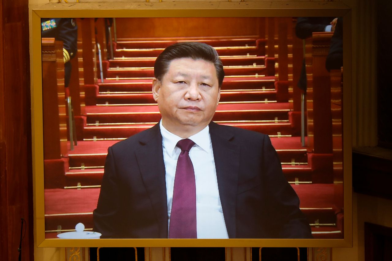 Chinese President Xi Jinping is seen on a giant screen during the opening session of the Chinese People's Political Consultative Conference (CPPCC) on March 3, 2017 in Beijing.