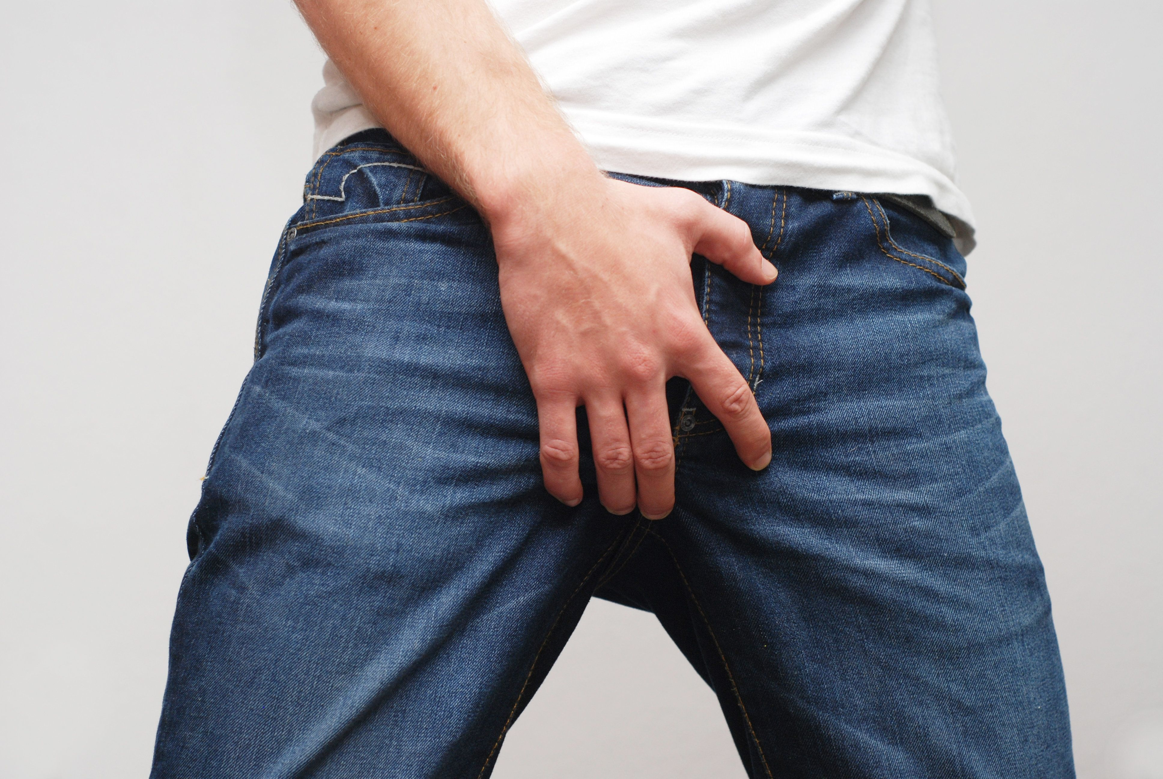 man with blue jeans close up