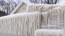 Entire House Completely Frozen Along Lake