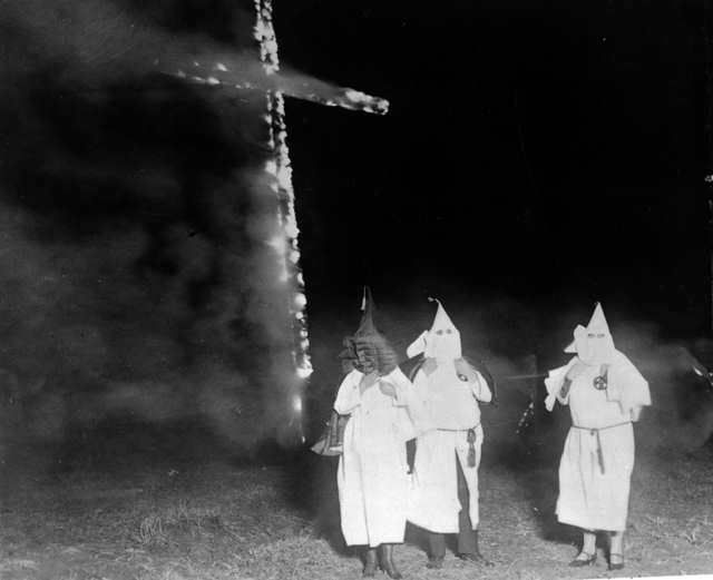The Ku Klux Klan burning a cross in 1921.