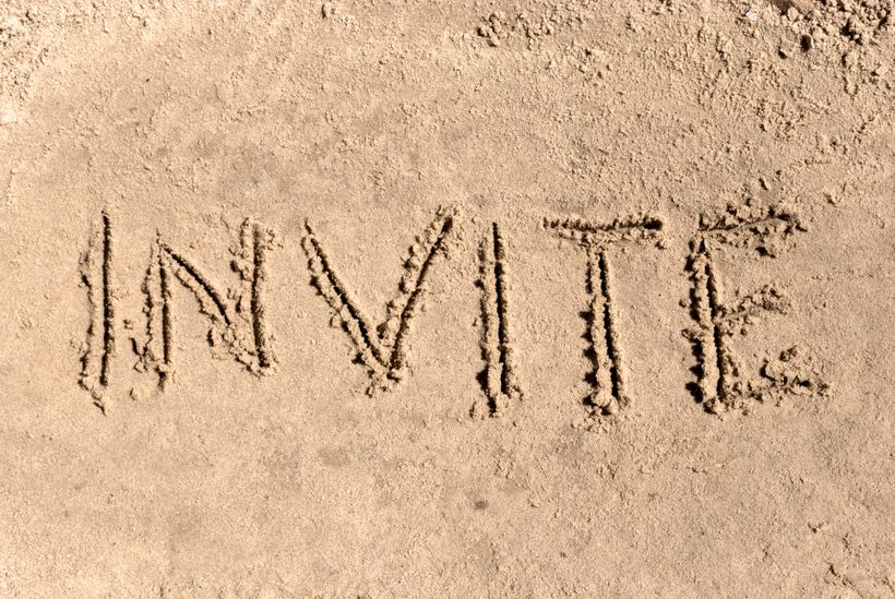 INVITE written in the sand