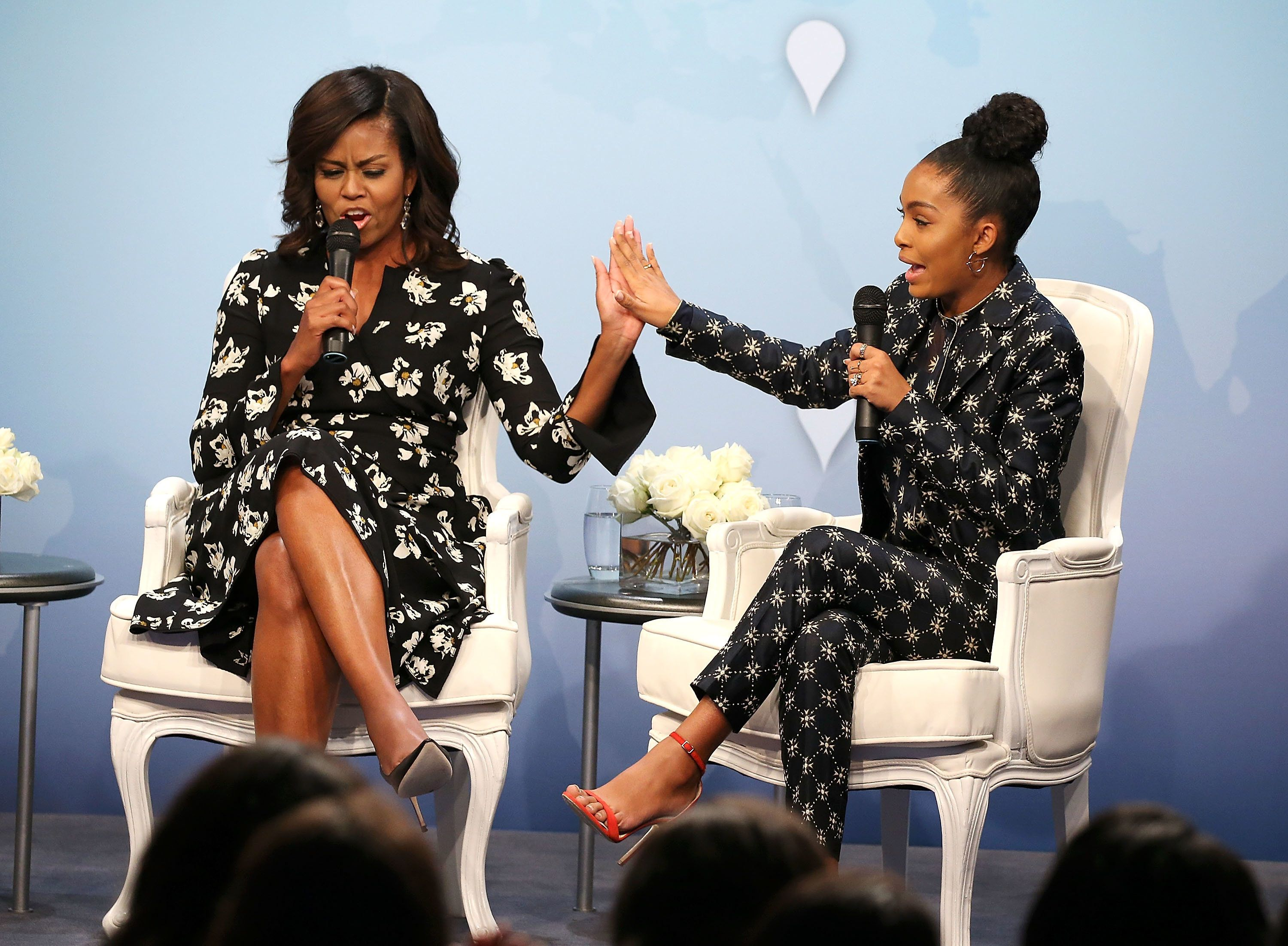 WASHINGTON, DC - OCTOBER 11:  First Lady of the United States Michelle Obama (L) greets actress and activist Yara Shahidi with a 'high five' during a panel discussion at Glamour Hosts 'A Brighter Future: A Global Conversation on Girls' Education' with First Lady Michelle Obama at The Newseum on October 11, 2016 in Washington, DC.  (Photo by Paul Morigi/Getty Images for Glamour)