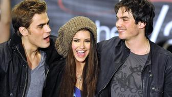 CANOGA PARK, CA - FEBRUARY 13: Paul Wesley, Nina Dubrev and Ian Somerhalder pose for a picture at 'The Vampire Diaries' Hot Topic tour at the Westfield Topanga Mall on February 13, 2010 in Canoga Park, California. (Photo by Toby Canham/Getty Images)