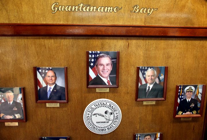 A photo of President Bush hangs alongside other government and military leaders in the headquarters of the U.S. Naval Base&nb