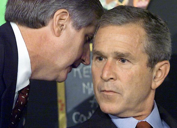 President Bush is informed of the attacks on the World Trade Center on Sept. 11, 2001, while attending a school reading