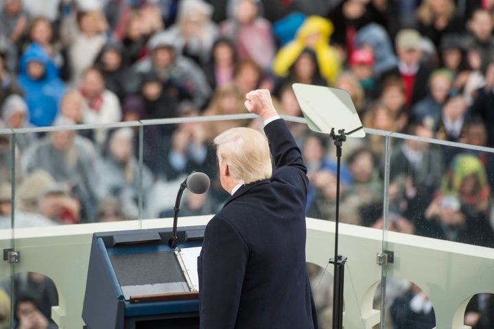 Donald Trump is inaugurated the day after three of his former aides are reported to be targets of an investigation into