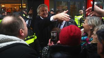 BREDA, NETHERLANDS - MARCH 08:  PVV Candidate, Geert Wilders is guarded by police as he speaks to the crowd, hands out pamphlets or flyers and poses for selfies on his election campaign near Van Coothplein on March 8, 2017 in Breda, Netherlands.  (Photo by Dean Mouhtaropoulos/Getty Images)