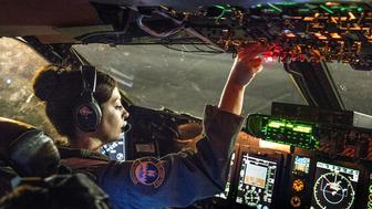 1st Lt. Meaghan Cosand, C-5B Galaxy pilot with the 312th Airlift Squadron, starts engines in preparation for takeoff from Kadena Air Base, Japan, Aug. 15, 2014. She was flying a mobility channel mission, moving high-priority cargo and passengers among air bases in the U.S. Pacific Command area of responsibility.  (U.S. Air Force photo/Lt. Col. Robert Couse-Baker)