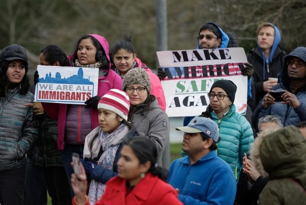 Members of the South Asian community and others attend a peace vigil for Srinivas Kuchibhotla, the 32-year-old...