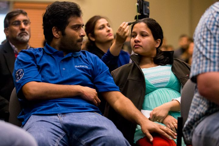 Alok Madasani and his wife Reepthi Gangula tear up while watching a dedication video during the Prayer Vigil that was held fo