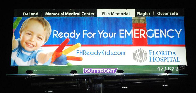 <em>After: the same billboard lit by energy-saving LED lights</em>