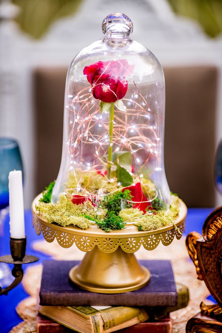 Tiny string lights add a magical quality to the enchanted rose.