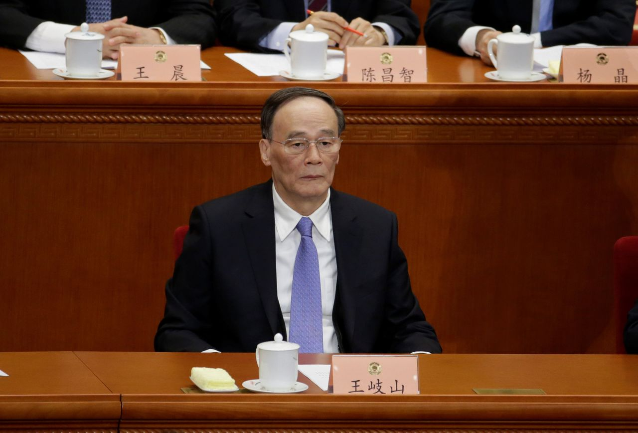 China's Politburo Standing Committee member Wang Qishan at the CCPPCC opening session in Beijing.