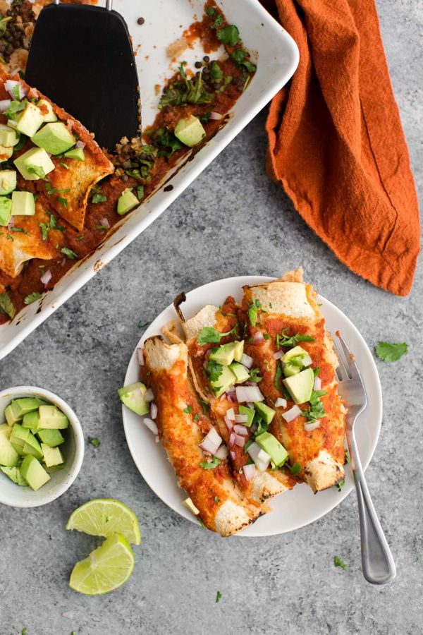 """<strong>Get the <a href=""""https://naturallyella.com/spinach-enchiladas-with-lentils/"""" target=""""_blank"""">Spinach Enchiladas with"""