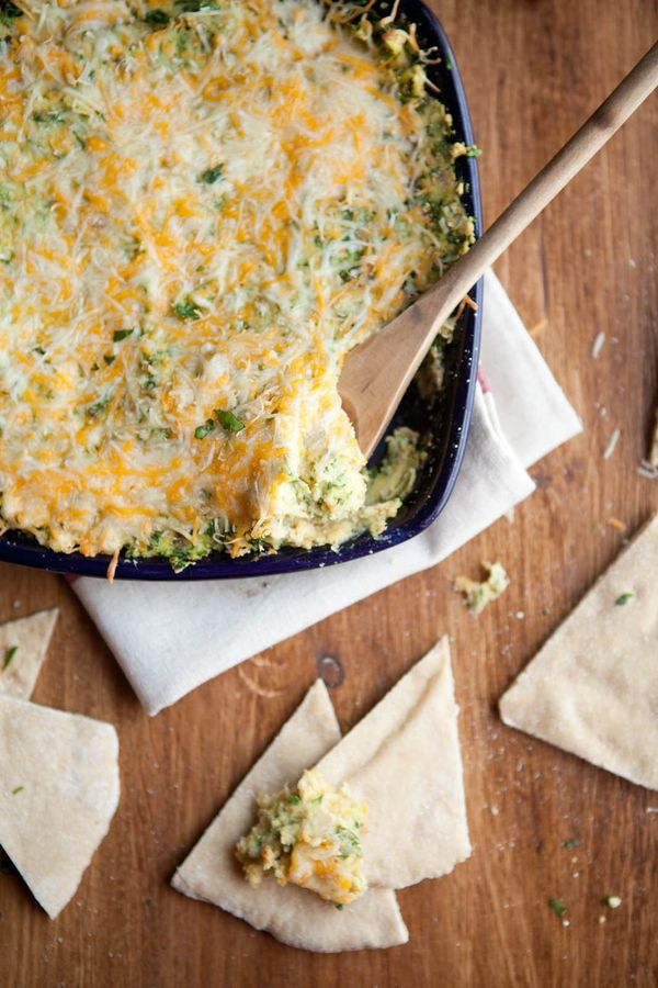 """<strong>Get the <a href=""""https://naturallyella.com/baked-hummus-and-spinach-dip/"""" target=""""_blank"""">Hummus And Spinach Dip reci"""