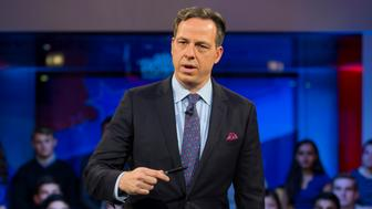 CAMBRIDGE, MA - DECEMBER 01:  Jake Tapper, of CNN's State of the Union, speaks to a crowd at the Harvard Institute of Politics Forum before Trump Campaign Manager Kellyanne Conway and Clinton Campaign Manager Robby Mook enter the room for an event titled 'War Stories: Inside Campaign 2016' on December 1, 2016 in Cambridge, Massachusetts.  (Photo by Scott Eisen/Getty Images)
