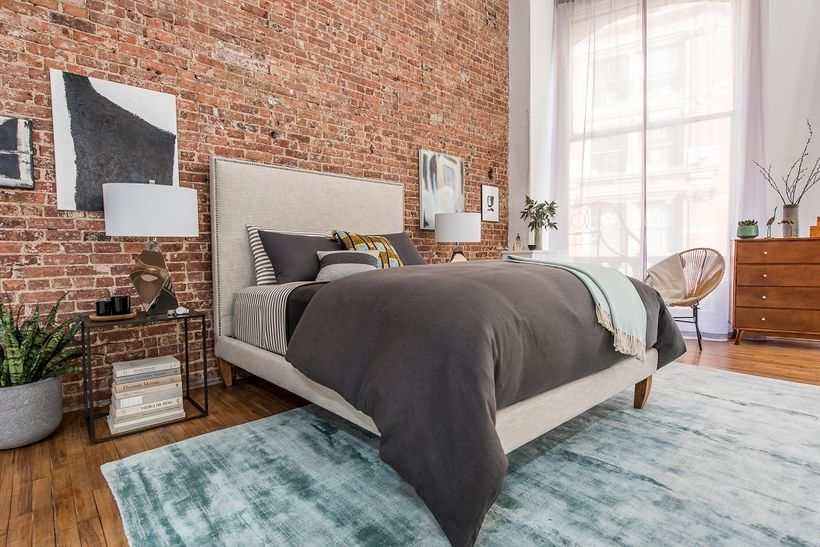 To have tranquility in your bedroom, Jonathan Scott says you can add densely woven draperies, thick area rugs and extra pillo