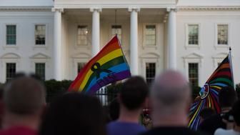 People hold a vigil in front of the White House in Washington, DC on June 12, 2016, in reaction to the mass shooting at a gay nightclub in Orlando, Florida.  Fifty people died when a gunman allegedly inspired by the Islamic State group opened fire inside a gay nightclub in Florida, in the worst terror attack on US soil since September 11, 2001. / AFP / Andrew Caballero-Reynolds        (Photo credit should read ANDREW CABALLERO-REYNOLDS/AFP/Getty Images)