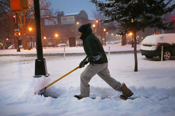 A man shovels snow on March 14, 2017 in New York City.