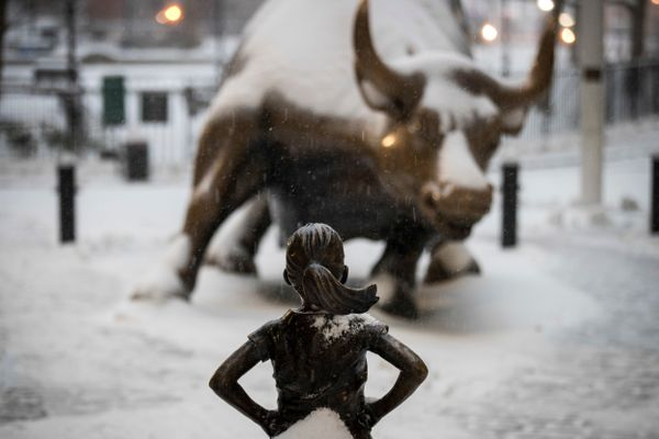The Fearless Girl statue continues to face off against the Charging Bull in New York City's snowy Financial District on March