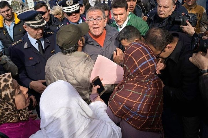 Greece's migration minister Ioannis Mouzalas is mobbed by furious refugees outside the Elliniko camp in Athens.