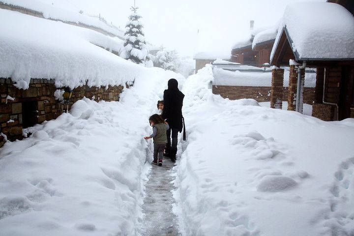 Syrian refugees in the deep snow at a ski chalet in the Greek mountains above Grevena.