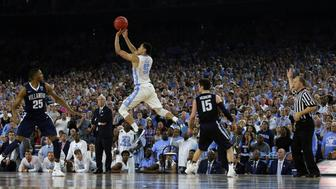 Apr 4, 2016; Houston, TX, USA; North Carolina Tar Heels guard Marcus Paige (5) hits a three point shot with 4.7 seconds over Villanova Wildcats guard Ryan Arcidiacono (15) in the championship game of the 2016 NCAA Men's Final Four at NRG Stadium. Mandatory Credit: Bob Donnan-USA TODAY Sports