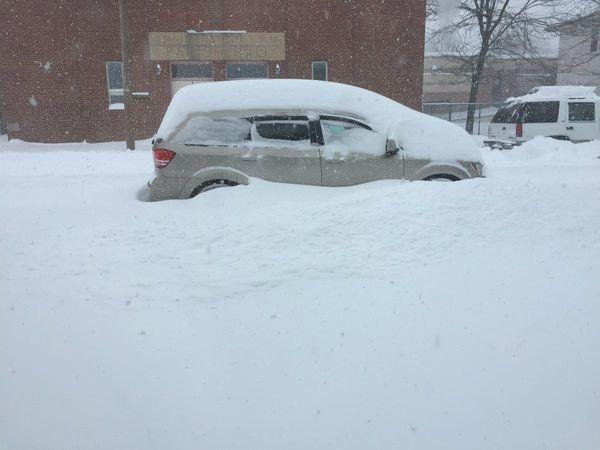 Snow covers a van in Frackville, Pennsylvania, on March 14, 2017.