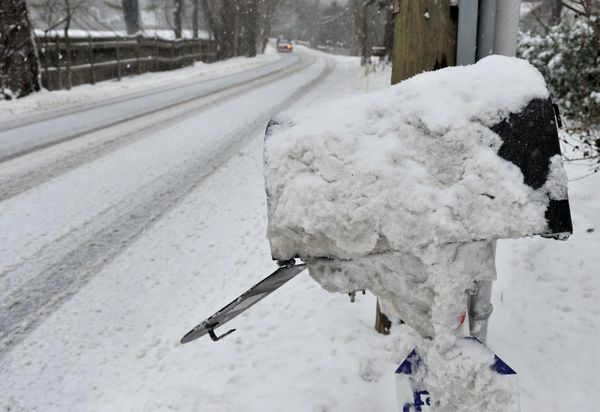 Snow covers a mailbox on a back road in Greenwich, Connecticut, on March 14, 2017.