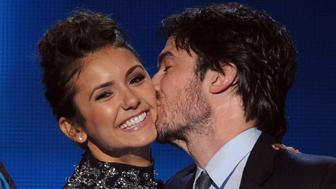 LOS ANGELES, CA - JANUARY 08:  Actors Nina Dobrev (L) and Ian Somerhalder, winners of the Favorite On Screen Chemistry award for 'The Vampire Diaries,' speak onstage at The 40th Annual People's Choice Awards at Nokia Theatre L.A. Live on January 8, 2014 in Los Angeles, California.  (Photo by Kevin Winter/Getty Images)