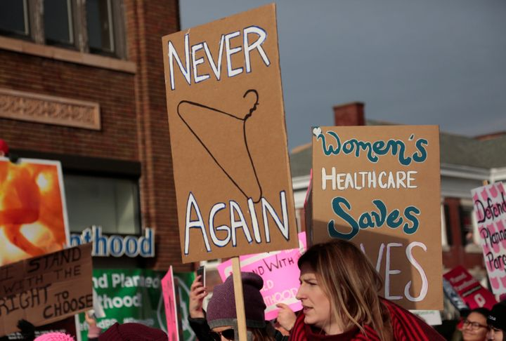 Supporters of Planned Parenthood rally outside a Planned Parenthood clinic in Detroit on Feb. 11, 2017.