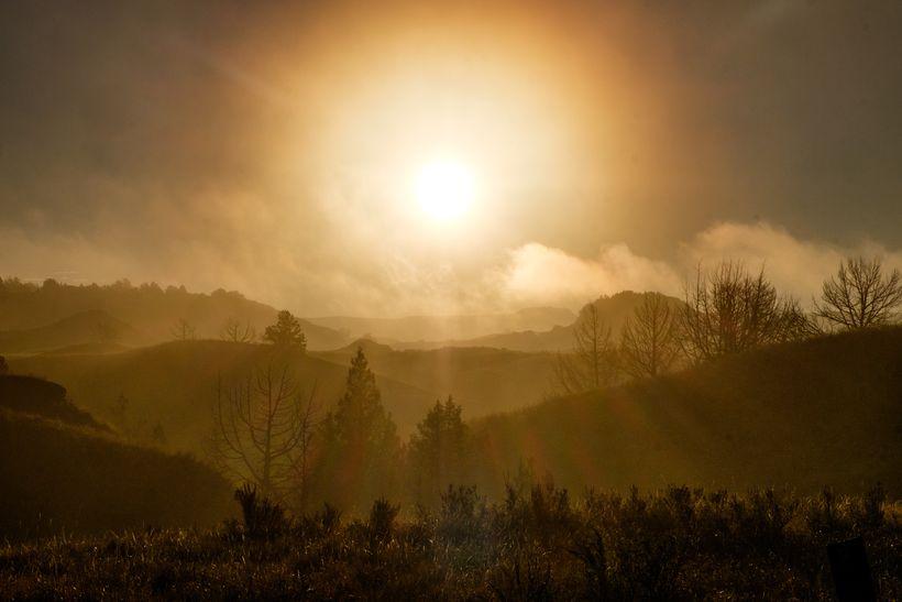 <em>A bold sunrise over Theodore Roosevelt National Park in North Dakota.</em>