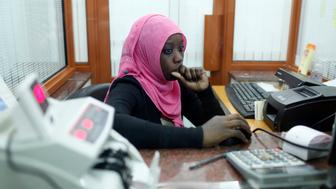 Muslim bank employee. (Photo by: BSIP/UIG via Getty Images)