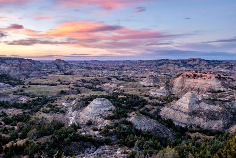 <em>Colorful badland formations and forest at Painted Canyon in the south unit.</em>