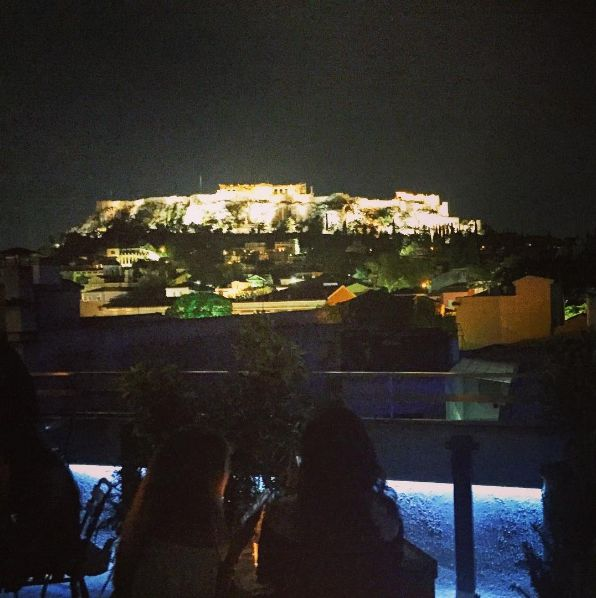 Young girls at a roof garden bar with Acropolis view