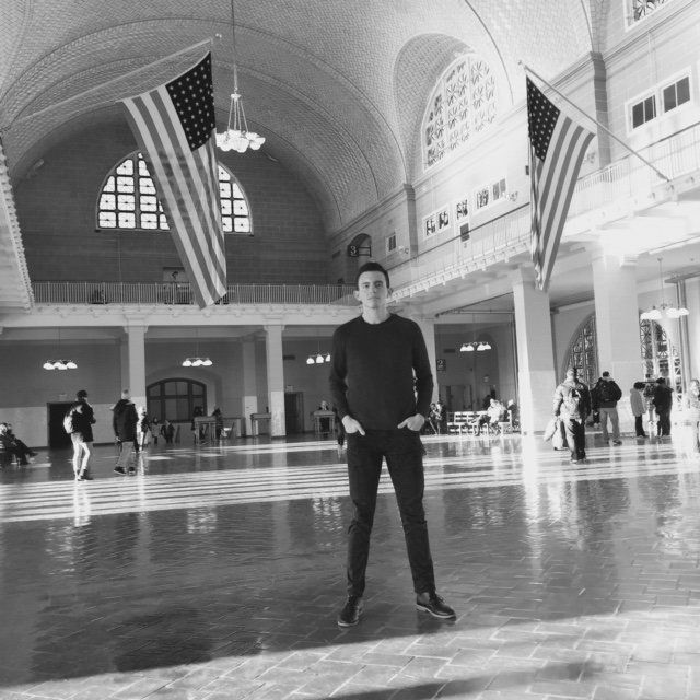Mancheno, a gay refugee immigration lawyer, visits Ellis Island, where millions of immigrants first landed...