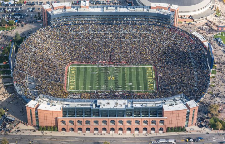 Aerial photo of Michigan Stadium, October 2016, with over 107,500 seats. The number of Americans projected to lose health ins