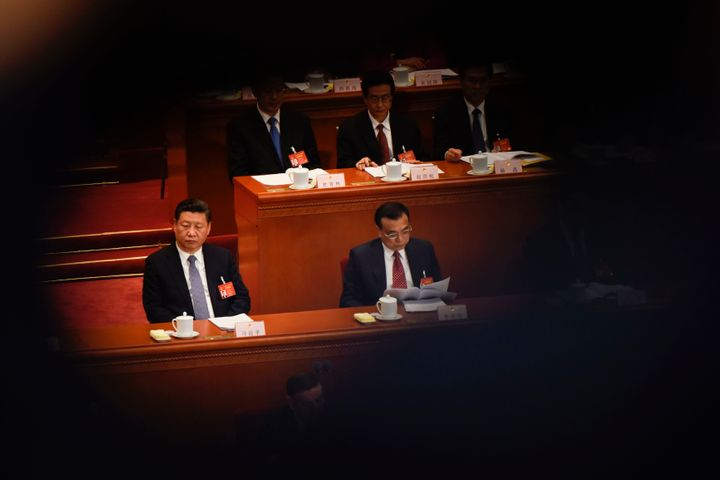 Xi Jinping and Li Keqiang attend the National People's Congress. March 8.