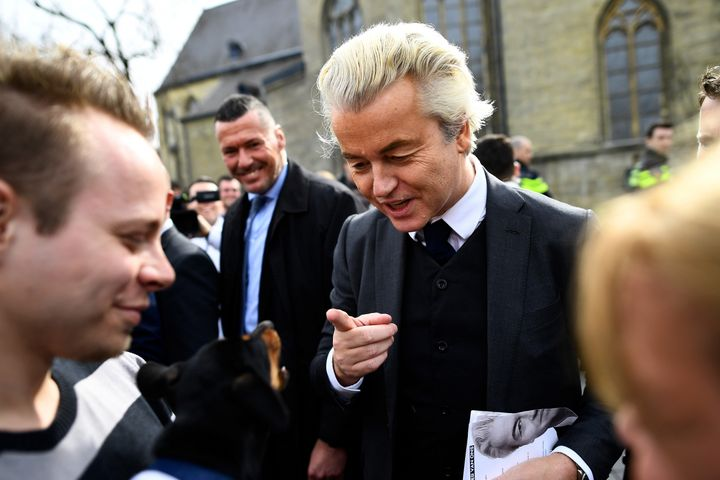 Dutch far-right politician Geert Wilders of the PVV party reacts as a dog barks at him as he campaigns in Valkenburg, Netherl