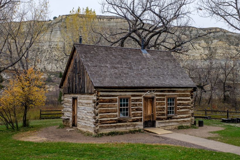 <em>A year after his first visit in 1883, he invested $14,000 in the Maltese Cross Cabin, where he lived briefly before he bu