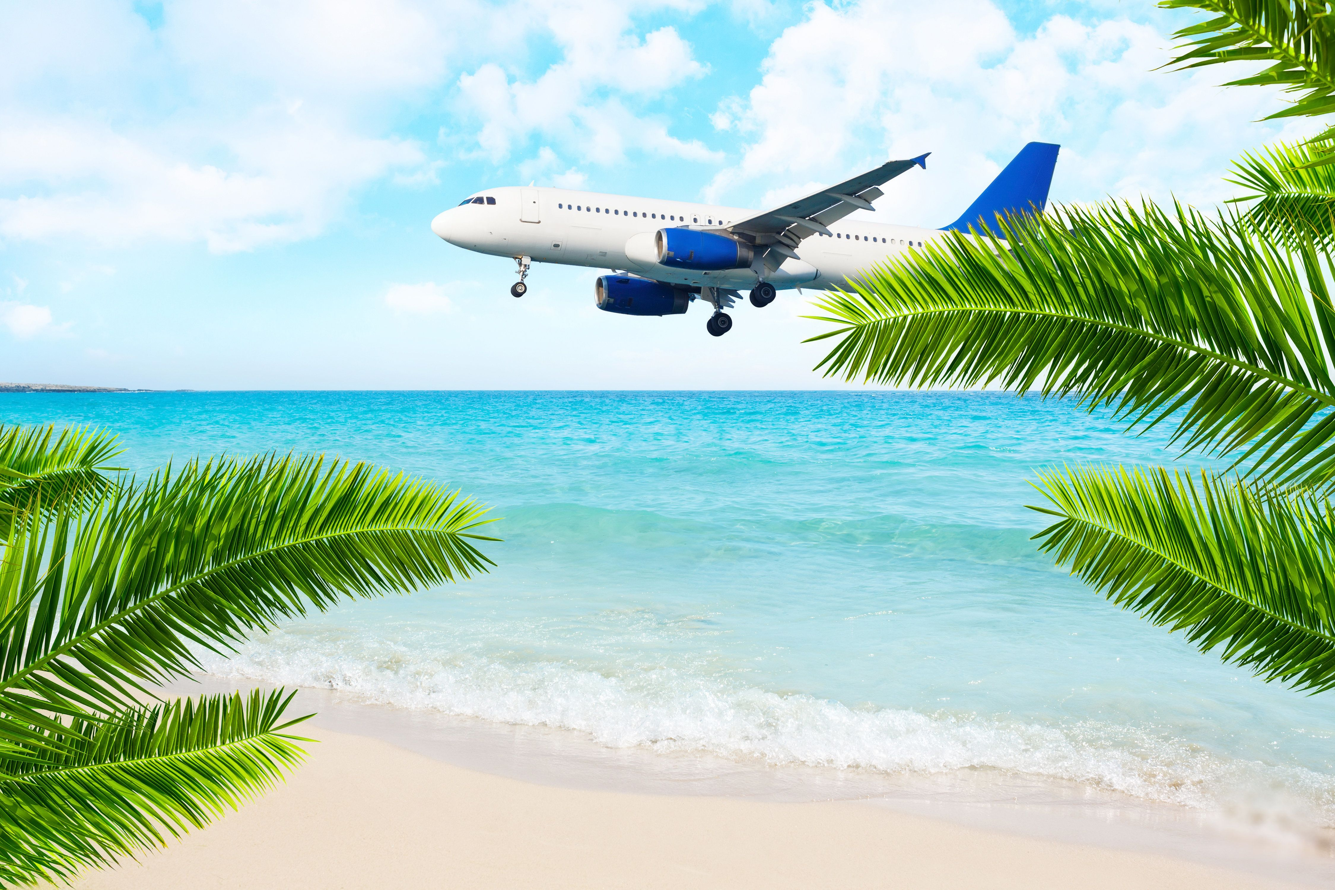 Jet airplane landing over the sea beach. Final approach. Vacation destination.