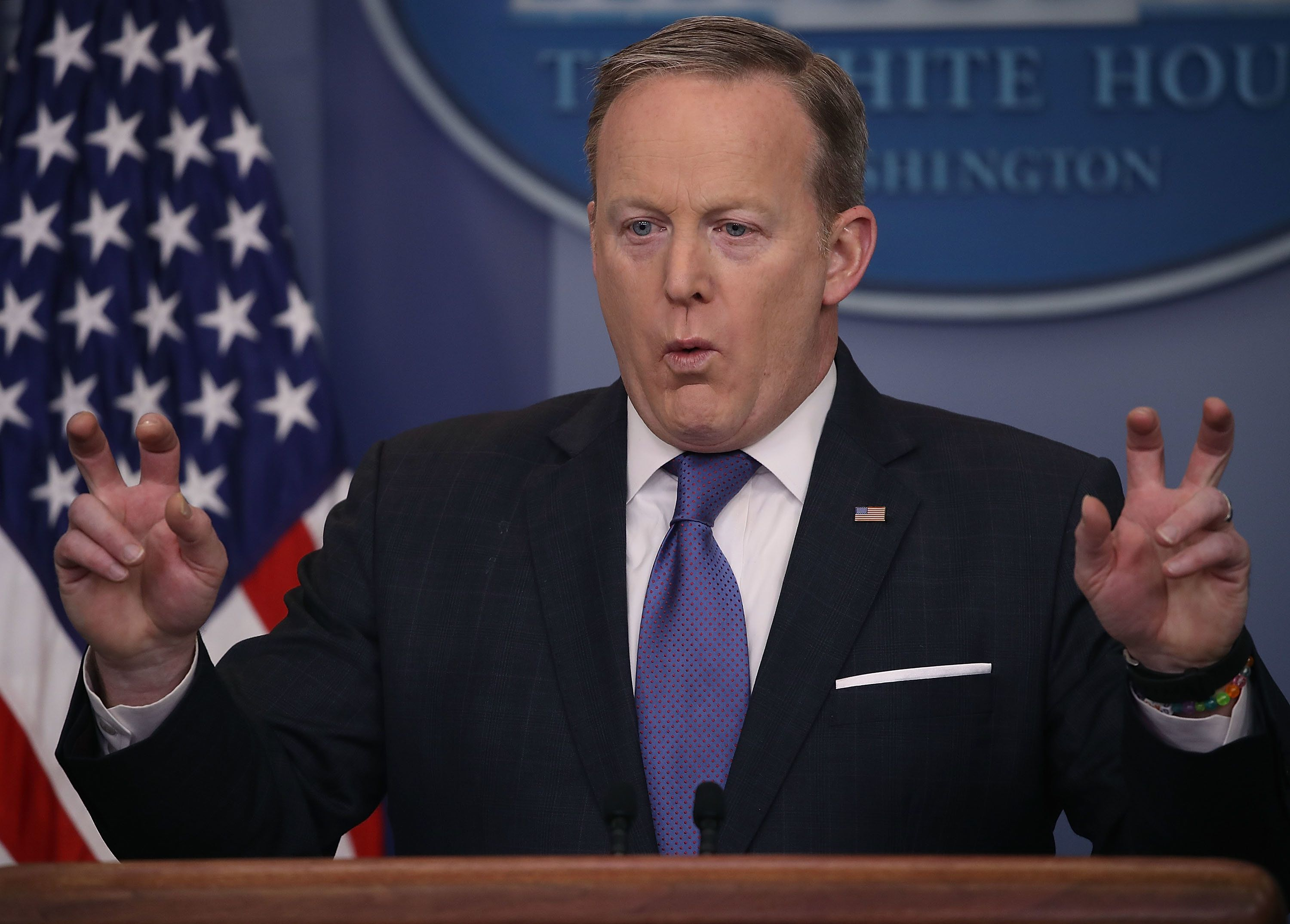 "White House press secretary Sean Spicer on Monday used air quotes to signify that Trump did not necessarily mean ""wire tappin"