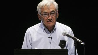 LOS ANGELES, CA - OCTOBER 05:  Author Howard Zinn, reads on stage at the Celebrity Reading Of 'Voices Of A People's History Of The United States' held at the Japan America Theatre, on October,2005 in Los Angeles, California.  (Photo by Frazer Harrison/Getty Images)