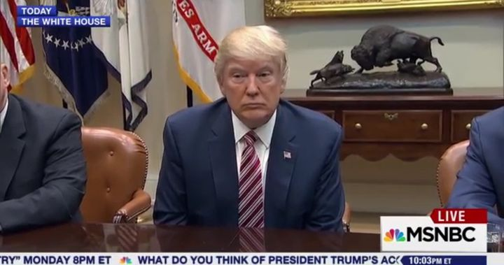 The President sits passively silent while reporters pepper him with questions on March 10, 2017.