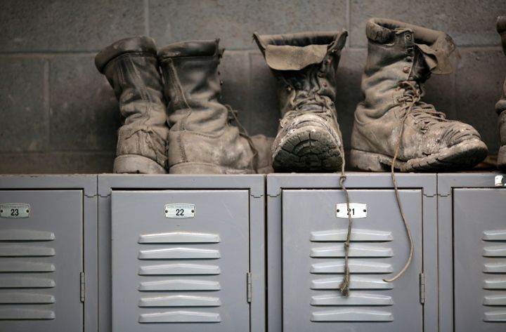 Miners' boots sit atop their lockers before the start of an afternoon shift at a coal mine near Gilbert, West Virginia.