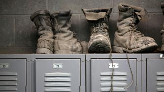 Coal mining boots are shown above miners' lockers before the start of an afternoon shift at a coal mine near Gilbert, West Virginia May 22, 2014.  REUTERS/Robert Galbraith/File Photo               GLOBAL BUSINESS WEEK AHEAD PACKAGE - SEARCH 'BUSINESS WEEK AHEAD 24 OCT'  FOR ALL IMAGES