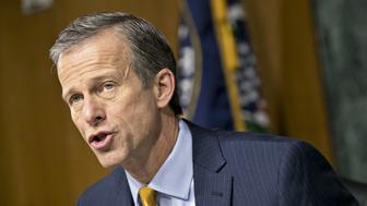 Senator John Thune, a Republican from South Dakota, makes an opening statement during a Senate Commerce, Science and Transportation Committee hearing in Washington, D.C., U.S., on Wednesday, March 1, 2017. President Donald Trump confirmedin his Tuesday night speech that he will ask Congress to approve a$1 trillion infrastructure bill. Photographer: Andrew Harrer/Bloomberg via Getty Images