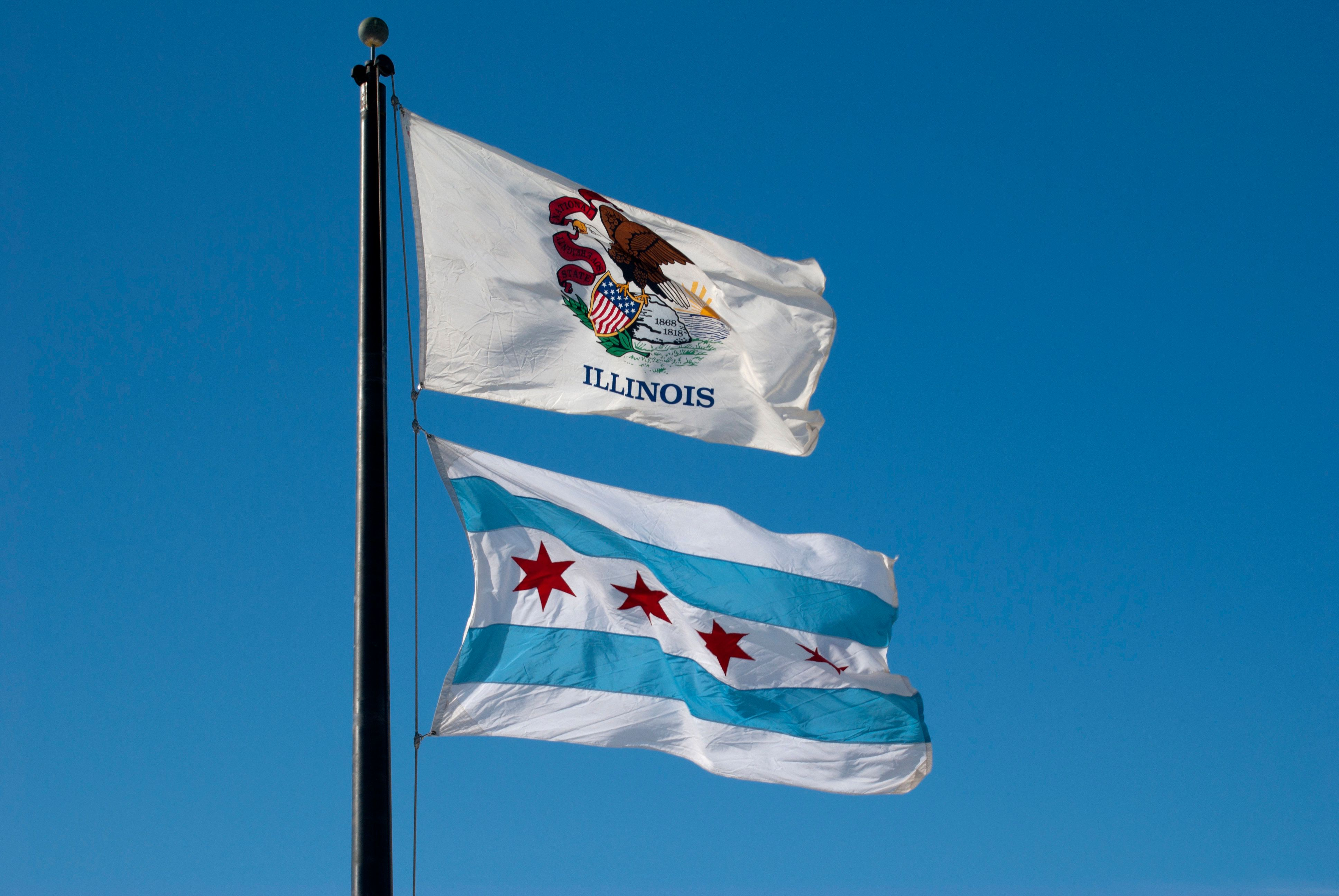 The Flag of the State of Illinois  and the municipal flag of the city of Chicago(below)